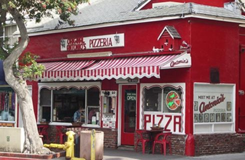 Store front of Original Antonio's Pizzeria restaurant with red brick and red and white paint